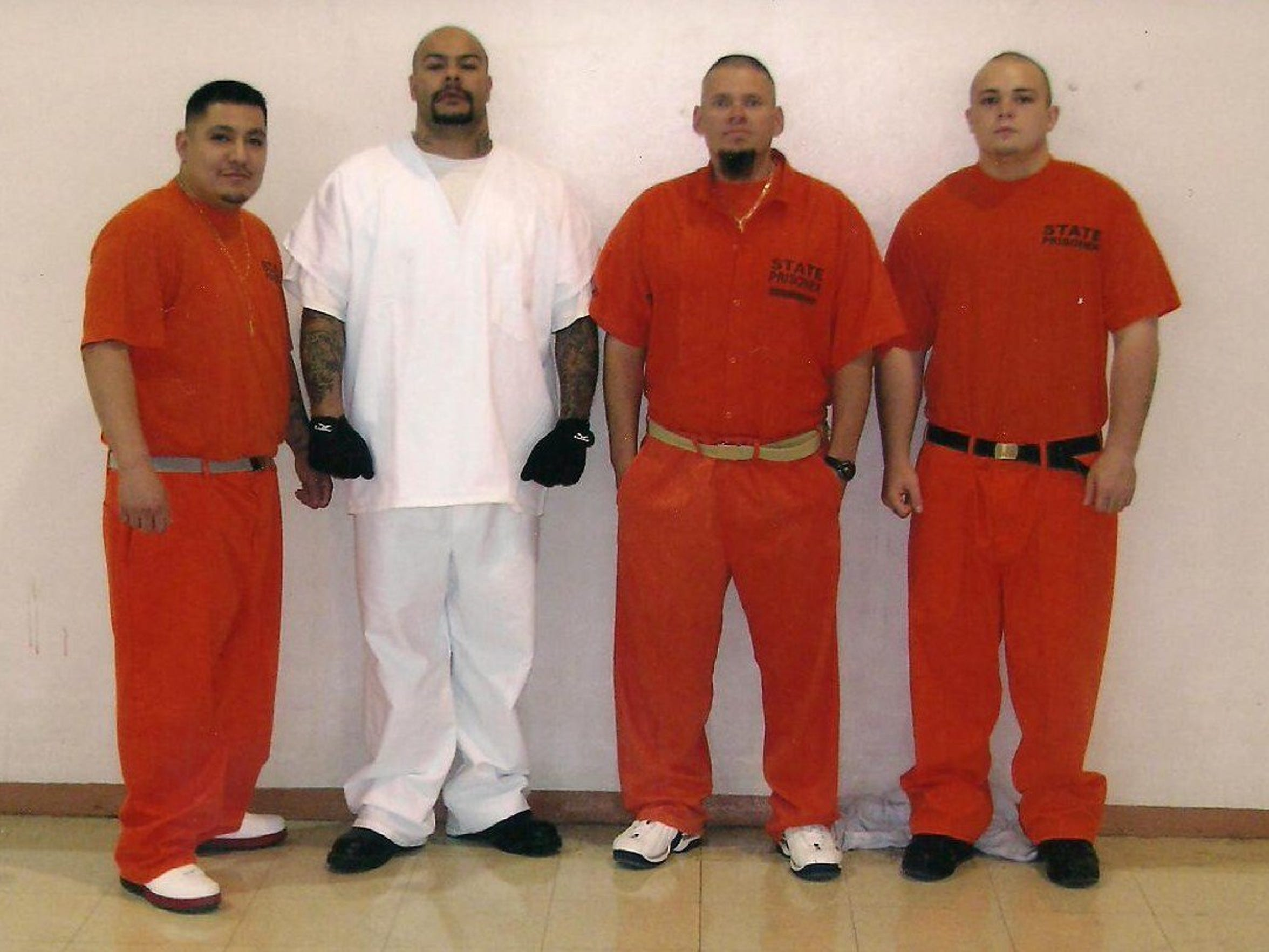 Pastor John Alarid (third from left) served time in the New Mexico Department of Corrections.