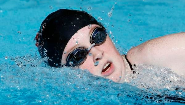 Albertus Magnus junior Theresa Hutton in action during girls swimming practice at the Henry Kaufman Campgrounds, Aug. 26, 2014 in Pearl River.