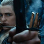 "Legolas (Orlando Bloom) draws a bead on a target in ""The Hobbit: The Desolation of Smaug.""   Warner Bros. Pictures"