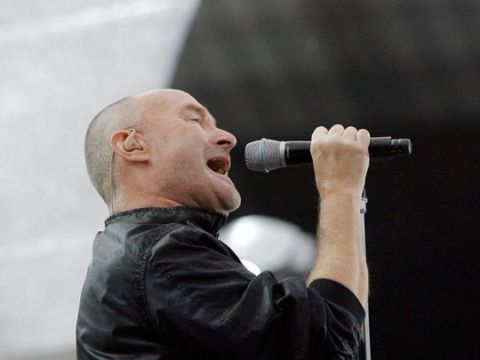 Phil Collins sings during a concert of the band Genesis