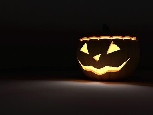 Halloween Jack O Lantern Pumpkin on dark background