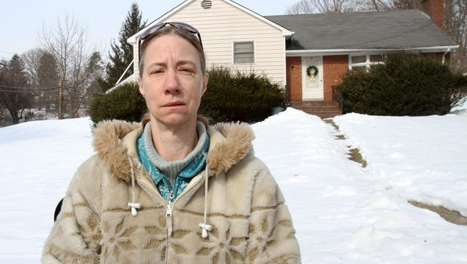 Louise Dennen of Briarcliff is photographed in front of her house, on which she and her brother owe $45,000 in taxes, fees and penalties and may lose any time to foreclosure  Feb. 25, 2014.