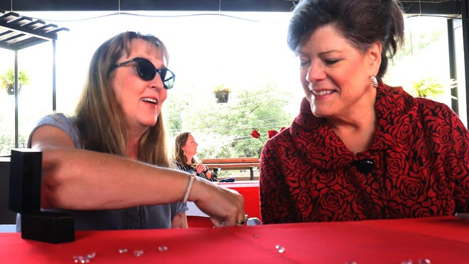Liz Martin, left, shows Lady Jane Cohen the Vahan bracelet from Newton's Jewelers she won, Thursday, Sept. 24, during the annual annual Beauty and Beads Luncheon & Jewelry Auction at The Bakery District. The Arkansas Single Parent Scholarship Fund provides scholarships to single parents to help with their education.