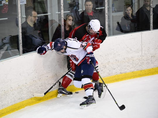 Battling along the boards are Franklin's Colin Judge