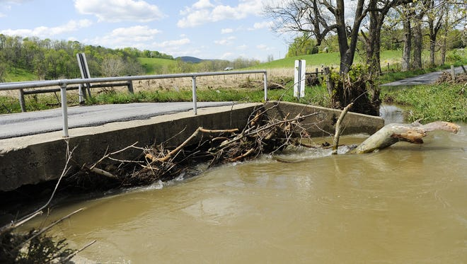 Debris collections under the bridge crossing Middle River on May 9, 2013, after three days of flooding at Robert Whitescarver's farm and the surrounding areas in Swoope.