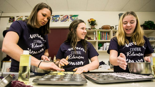 "From left, Central York Middle School teacher advisor Kelly Beck, eighth-grader Taylor Haas and seventh-grader Emilee Myers, put together trays of bath fizzles to be baked Wednesday, Feb. 1, 2017, during a Central Relaxation class. Central Relaxation is a student run business. Students have developed ""fizzles"" and other relaxation products that are currently being sold online and in business. Amanda J. Cain photo"