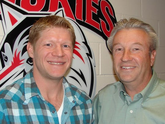 Former St. Cloud State forward Mark Parrish (left)