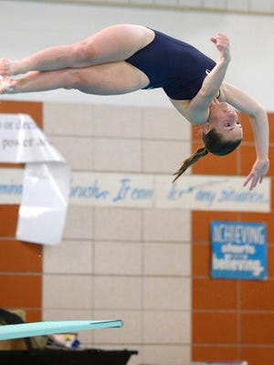 Victor's Erin Norton executes a dive during regular season meet against Pittsford at Pittsford Mendon High School on Sept. 8, 2016.