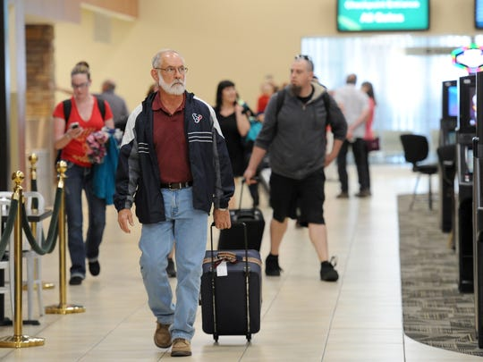 Passengers arrive at the Reno Tahoe International Airport in April 2014.