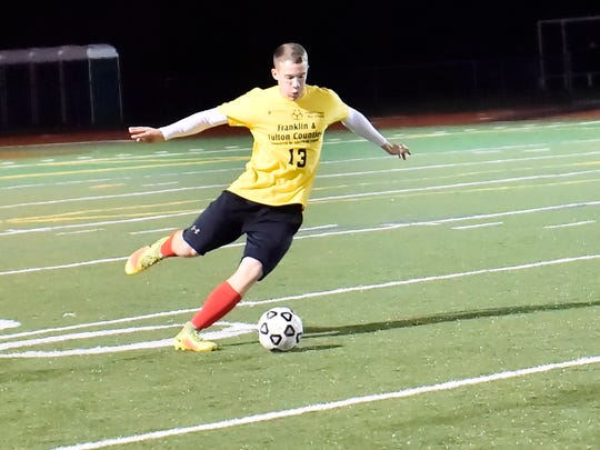 Wyatt Thorne (13) kicks the ball across the field during the Four-Diamonds All-Star soccer game on Wednesday, Nov. 9, 2016 in Greencastle, Pa.  Pennsylvannia All-Stars defeat Maryland 2-1 in Four-Diamonds boys game.