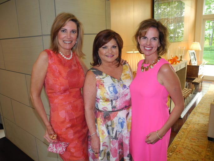 2014 Symphony Spring Fashion Show co-chairs Dara Russell, left, and Vicki Horne and Patron Party host Patti Smallwood at the 2014 Symphony Spring Fashion Show Patron Party, held at the Smallwood home.