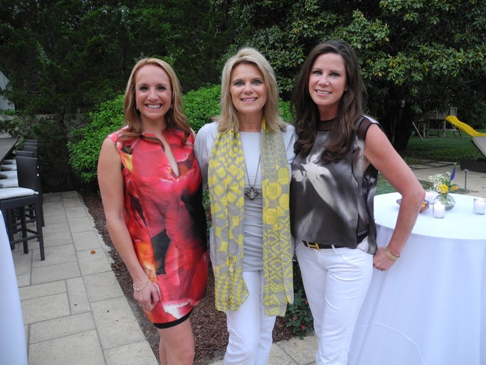 2014 Sunset Safari co-chairs Cynthia Arnholdt, left, Kerrie Johnson and Nora Kirby at the Nashville Zoo's Sunset Safari Committee Kickoff, held at the home of Nora and her husband Kent Kirby.