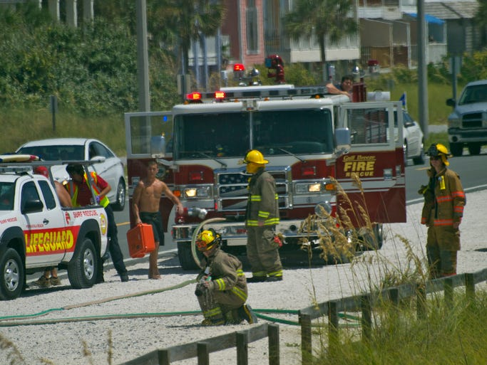 Emergency personnel gather along Fort Pickens Road during a rescue operation Monday, Sept. 1, at Pensacola Beach.
