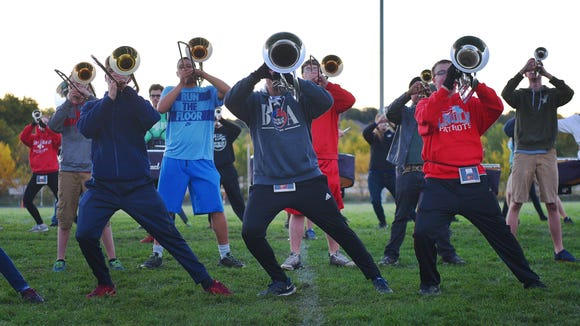 "Lincoln High School marching band practices their routine for Festival of Bands Wednesday, Oct. 4, before school on the football field. Festival of Bands USA is Saturday at ""Howard Wood Field."" The 27th Annual Festival of Bands USA is a musical event hosted and staffed by the band parents and Band Directors of Sioux Falls Lincoln, O'Gorman, Roosevelt and Washington High Schools."