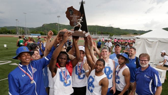The Oak Creek boys  celebrate their runner-up finish in the WIAA Division 1 state track and field meet Saturday in La Crosse.