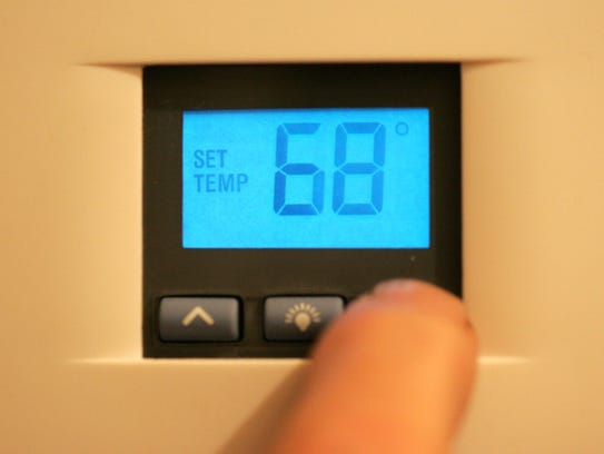 A thermostat is dialed down to 68 degrees at night