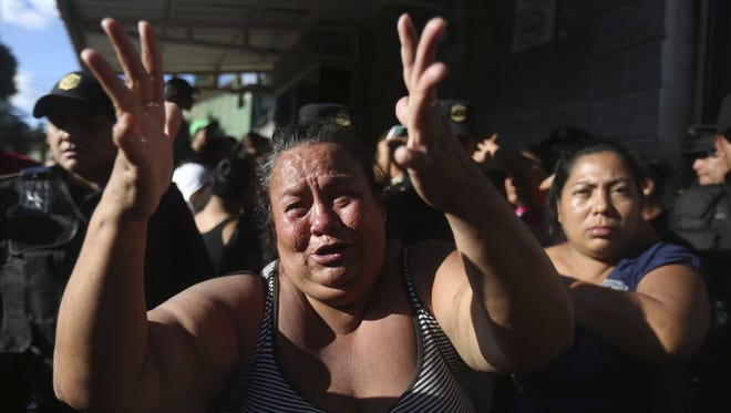 Relatives of the victims of a fire wait for information outside the Virgen de la Asuncion orphanage in Guatemala City, Guatemala, March 8, 2017.