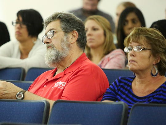 Woody Woodruff listens to speakers during a Christina School District board meeting Tuesday at Sarah Pyle Academy.