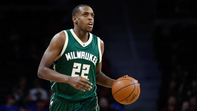 Khris Middleton dribbles the ball up the court during the second quarter against the Detroit Pistons at The Palace of Auburn Hills.