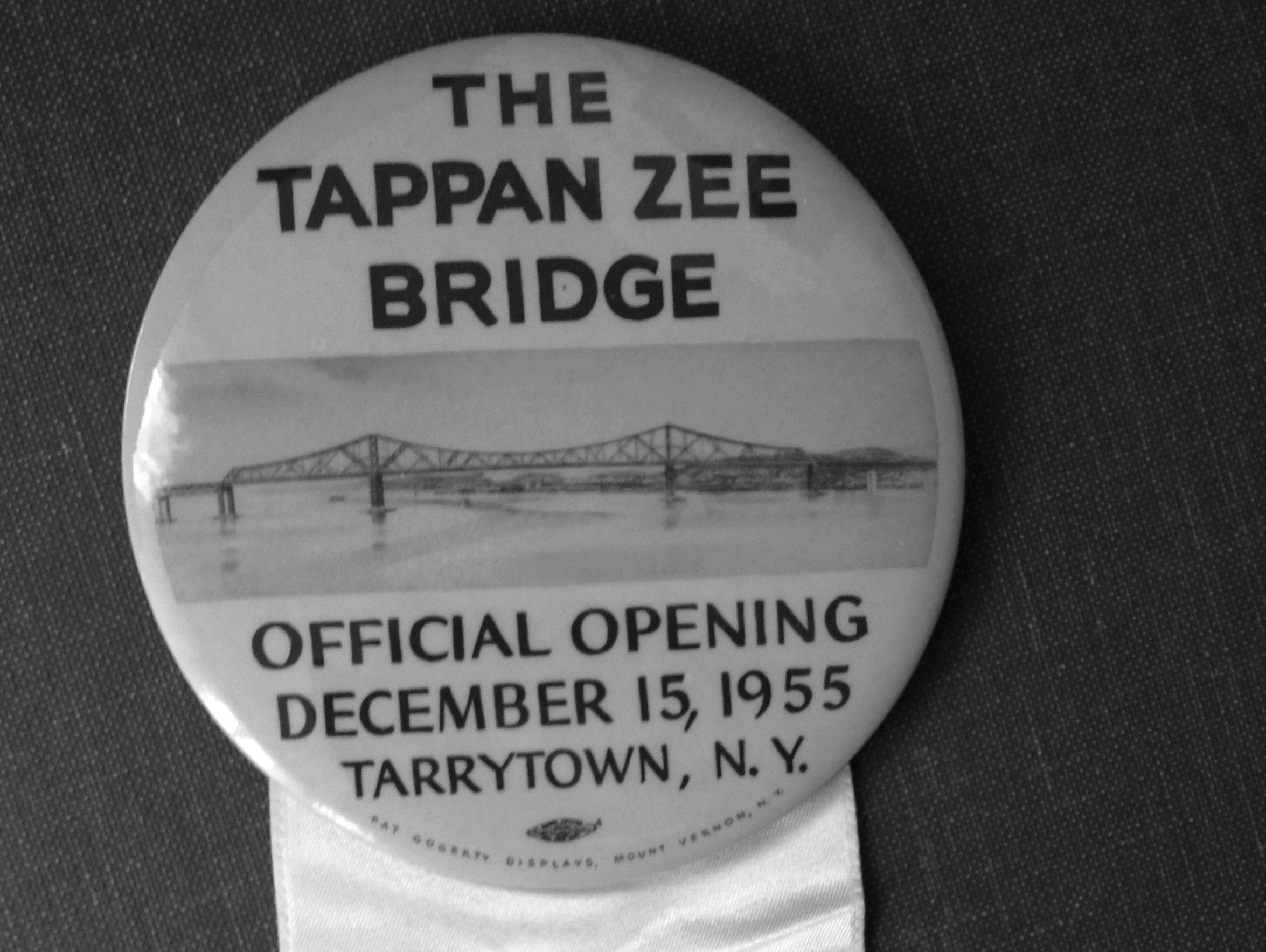 A button and ribbon commemorating the opening of the