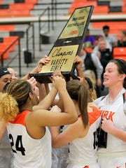 The Burkburnett girls hoist the championship trophy after winning the Union Square Lady Bulldog Classic Thursday afternoon.