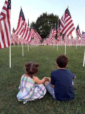 "Molly Slagle of McSherrystown submitted this photo to The Evening Sun. She writes, ""We went out on Saturday evening, Sept. 10, to visit the Healing Field in West Manheim. We tried to explain to our children Ellie Slagle, 2, left, and Evan, 6, about the loss of life that happened on 9/11, and how our country has tried to heal from that wound. We have tried to instill a sense of patriotism in our children, and this just seemed to capture the moment pretty well."""