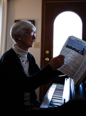 """""""I miss holding hands with him,"""" said Bev McCartney, as she recalled the walks she and her husband John used to go on. John McCartney was killed last year by a repeat OWI offender while McCartney was driving to get groceries. Here, she plays his old piano in their home on Friday, Jan. 20, 2017, in Fort Dodge."""