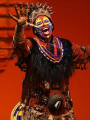"Tshidi Manye as Rafik in ""The Lion King."""