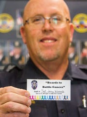"Cedar City Police Sgt. Jerry Womack holds his ""Beards"