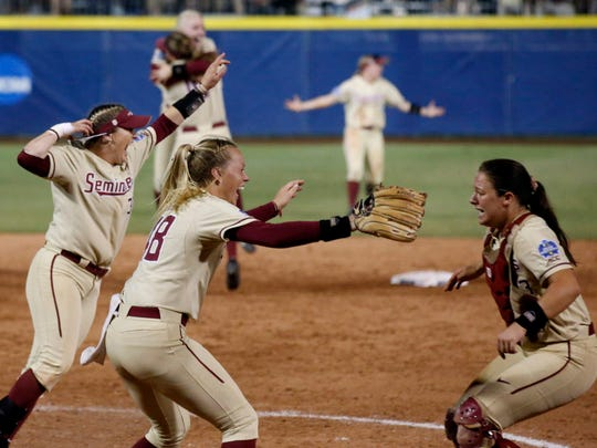 Florida State players celebrate after defeating Washington