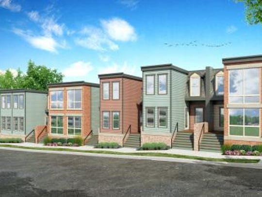 A rendering of the Hickory Place Townhomes under construction
