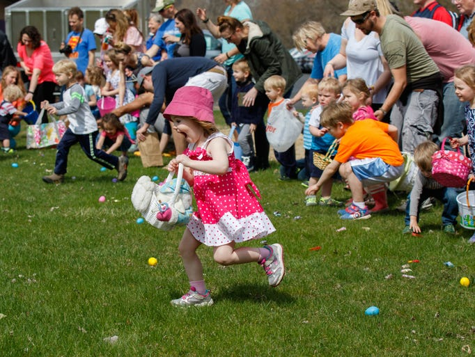 Youngsters race to collect treats during the Easter