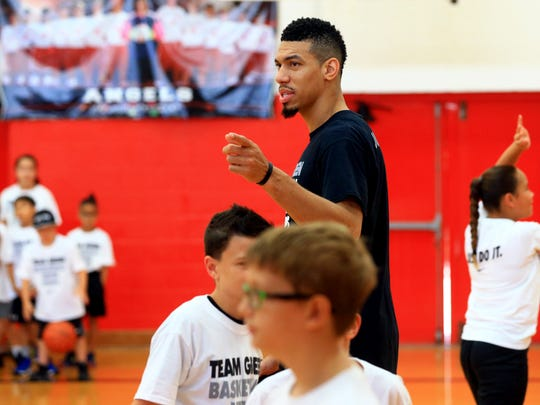 San Antonio Spurs' Danny Green watches kids work on basketball skills during the Danny Green Skills Clinic on Wednesday, July 12, 2017, at Incarnate Word Academy in Corpus Christi.