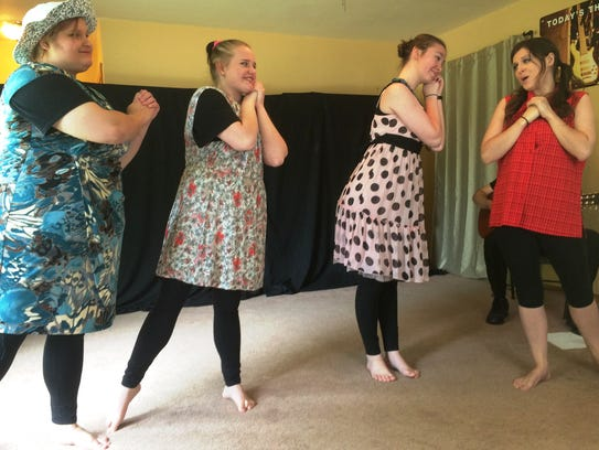 Huzzah Theatre Troupe members, from left, Emily Mathis,
