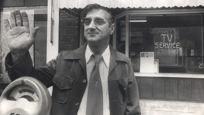 "July 31, 1976: John Peluso of Newport posed in front of the store which provided his nickname, Johnny ""TV"" Peluso."