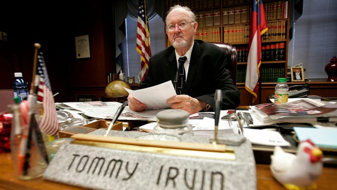 FILE - In this Jan. 28, 2009 file photo, then Georgia Commissioner of Agriculture Tommy Irvin works at his desk in Atlanta. Irvin, whose four decades in office made him one of the longest-serving statewide officials in U.S., died at the age of 88, the department he once ran confirmed Friday, Sept. 15, 2017. First appointed as state agriculture head in 1969 by then-Gov. Lester Maddox, Irvin went on to win 10 consecutive elections before deciding to retire in 2011 because of age and health reasons.