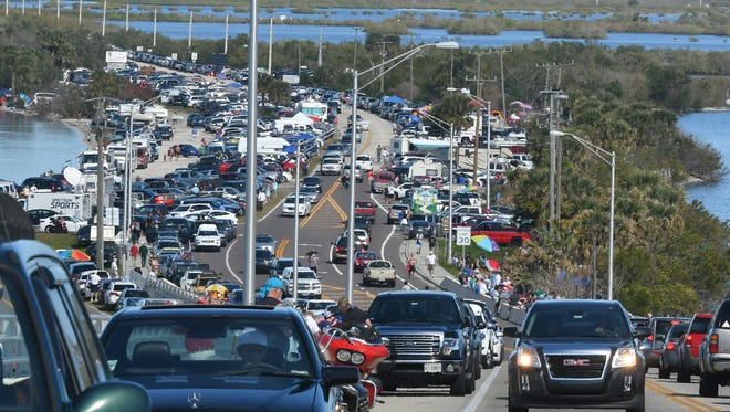 Spectators crowded near and on the A. Max Brewer Memorial Bridge in Titusville to watch the SpaceX Falcon Heavy launch Feb. 2, 2018.