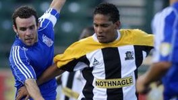 Rey Martinez, right, shown here playing for the Rhinos,