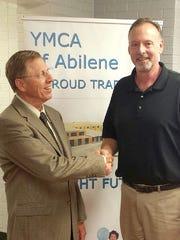 Allen Neece, president of the YMCA of Abilene board of directors, welcomes new board member John McLeod.