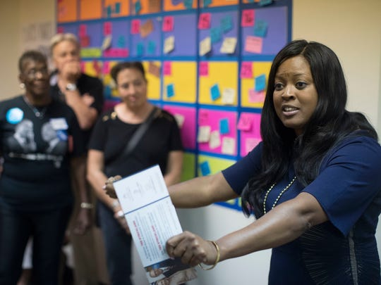 State Rep. Alicia Reece, a Democrat, speaks to supporters on Oct. 4 at a newly-opened organizing office for Democratic presidential candidate Hillary Clinton. The office is in Reece's home neighborhood of Roselawn. (AP Photo/John Minchillo)