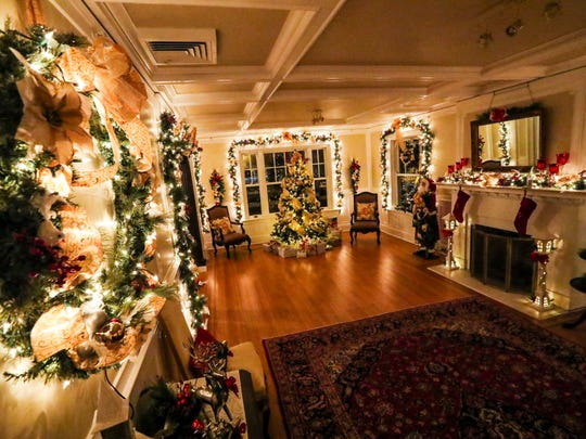 The Holiday House light display in downtown Fort Myers celebrates its 60th anniversary this year. The Fort Myers Woman's Community Club decorates both  historic Burroughs and Langford Kingston homes every year. The Holiday House opens to the public on Friday.