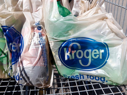 Bagged purchases from a Kroger sit inside a shopping