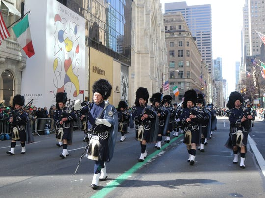The Police Pipes and Drums of Bergen County  make their way up Fifth Ave. after passing St. Patrick's Cathedral.