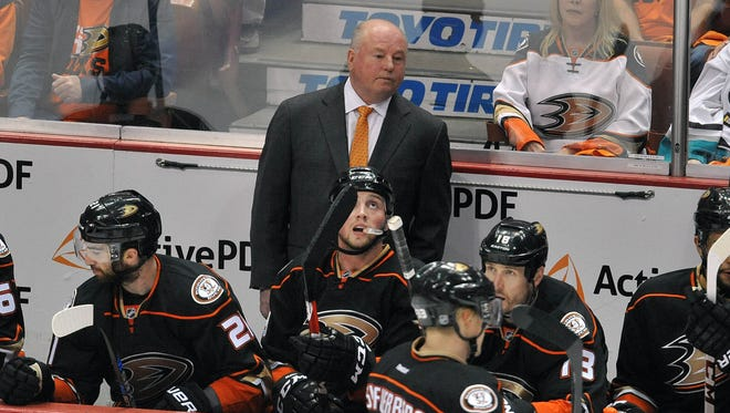 Anaheim Ducks head coach Bruce Boudreau watches game action against the Calgary Flames during the first period in game one of the second round of the 2015 Stanley Cup Playoffs at Honda Center.