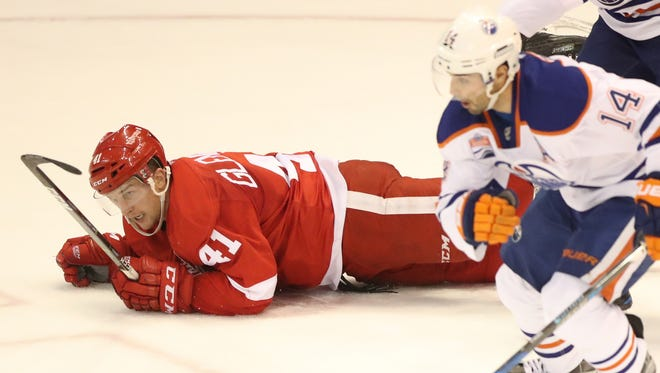 Detroit Red Wings forward Luke Glendening falls to the ice against the Edmonton Oilers on Nov. 6, 2016, at Joe Louis Arena in Detroit.