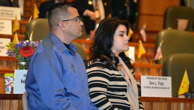 """Alan and Veronica Garcia, parents of Lilly Garcia, a 4-year-old killed in a road-rage shooting last year, listen to New Mexico lawmakers discuss a """"three-strikes"""" proposal aimed at violent offenders on Jan. 21 in Santa Fe."""