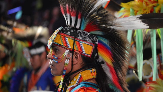 A dancer takes part in the grand entry to the Gathering of Nations on Friday, April 28, 2017 in Albuquerque, N.M. The Gathering of Nations, one of North America's most prominent American Indian powwows, is attracting thousands of dancers and as many as 100,000 attendees to New Mexico's largest city this week.