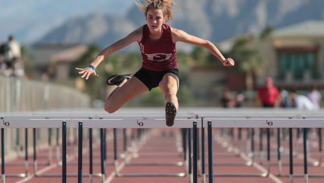 La Quinta's Isabella Fakehany wins the girls varsity 100 hurdles on Wednesday, April 25, 2018 in La Quinta.