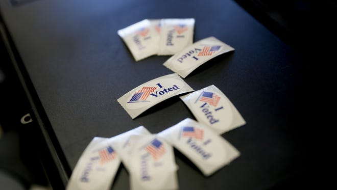 Voting stickers are pictured in this June 5, 2018 file photo at a polling station at the Bloomfield Multicultural Center. The filing date for candidates in Kirtland, Aztec or Bloomfield elections is Jan. 7, 2020.