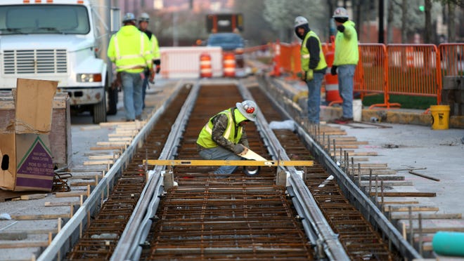 The cost of utility work to extend the streetcar line up the hill would be more than double the cost to relocate gas and electric lines on the Downtown and Over-the-Rhine loop, a document states. This image shows work done last spring.